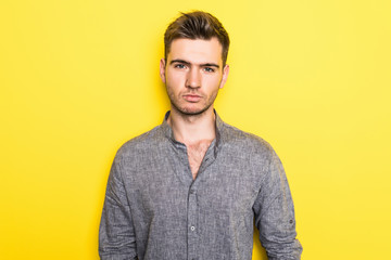 Portrait of Handsome man isolated on a yellow background