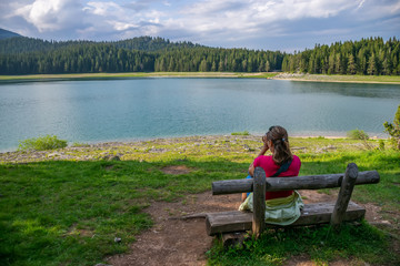 Romantic wooden benches near the Black Lake in Durmitor National Park. Montenegro