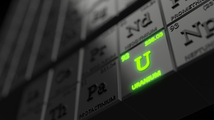 periodic table concept with black cubes. uranium element is glowing. 3d illustration