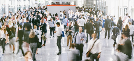 Anonymous Crowd of business people at a trade fair