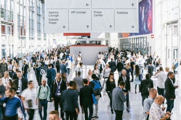 Fototapete - blurred people walking in a modern hall of a trade fair