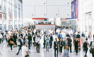Crowd of people walking on a trade show in london Wall mural