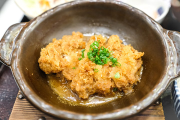 Crispy fried pork or Tonkatsu with miso sauce in the bowl. Japanese food.