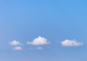 Blue sky with small white clouds.
