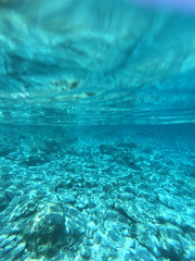 Underwater photo of exotic paradise island bay with turquoise clear sea