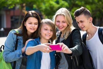Teenagers doing selfie outdoors