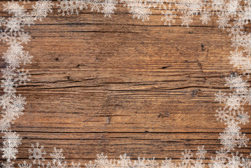 an old wood background and snowflakes