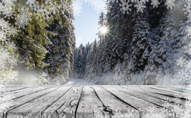 a wooden table and winter snow landscape with snowflakes