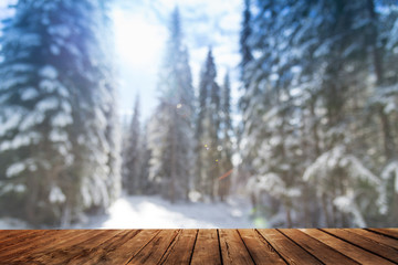 wooden table and winter forest landscape