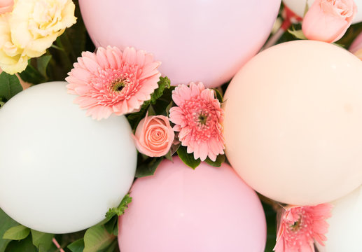 Pink flowers and balloons