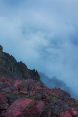 Mistic evening foggy landscape of wild nature in the mountains. Red stones. alien landscape