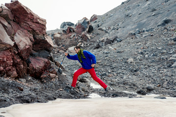 Man with ice ax moving over the glacier
