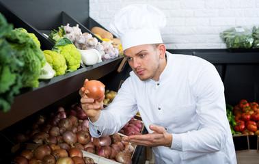 Man cook deciding on best vegetables