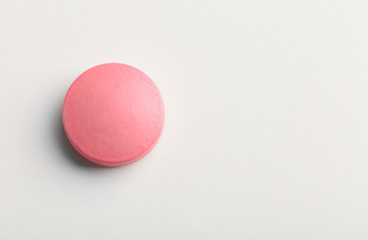 Colorful pill on white background