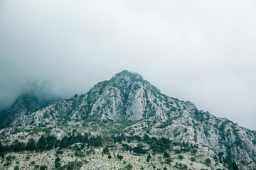 Beautiful view of the mountains in the fog in Montenegro. Natural landscape.