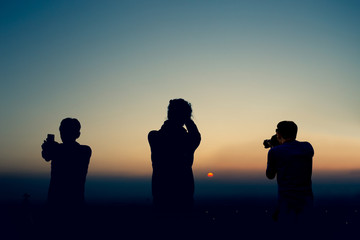 Silhouettes photographer taking pictures at sunset in Nahagarh Fort Jaipur.