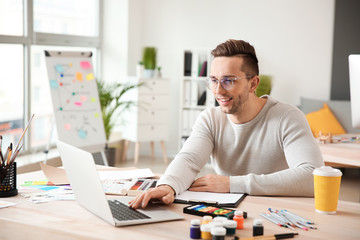 Young designer working in office