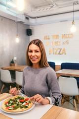 Girl in a restaurant.