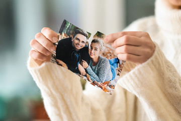 Woman tearing up photo of happy couple, closeup. Concept of divorce