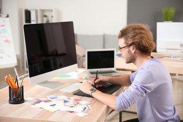 Young designer working in studio