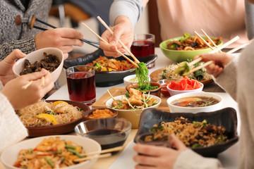 Aluminium Prints Picnic Friends eating tasty Chinese food at table