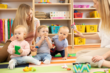 Babies is playing in nursery. Children in the daycare center. Fun in the children's playroom