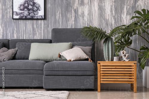 Wall mural Stylish interior of living room with comfortable grey sofa