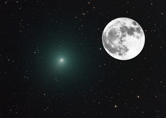 Composition with the Christmas Comet and a bright big Moon taken all two with telescope with many stars as background.
