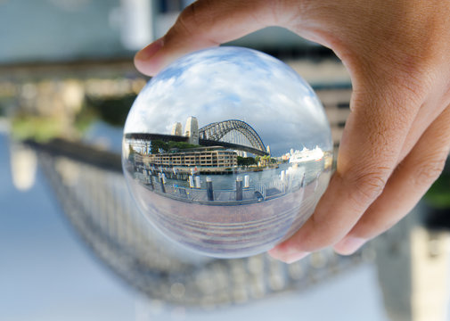 Sydney Harbour bridge photography in a clear glass crystal ball.