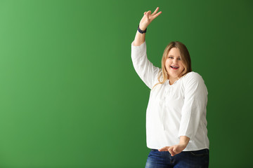 Happy plus size girl on color background. Concept of body positivity