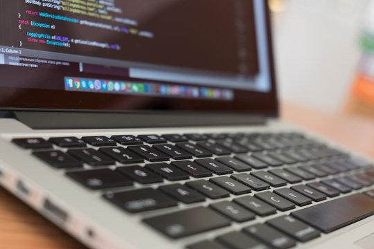 Developer notebook and  keyboard coding Java Script
