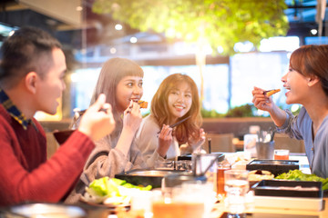 Obraz happy asian young Group  eating in the restaurant - fototapety do salonu