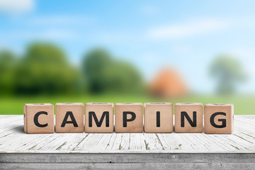 Camping word on a wooden cube sign