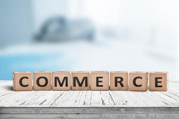 Commerce word on a wooden cube sign