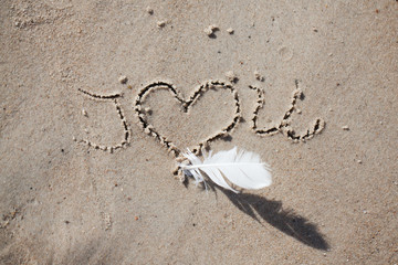 "inscription on the beach ""i love you"". holiday, beach, inscription on the sand,"