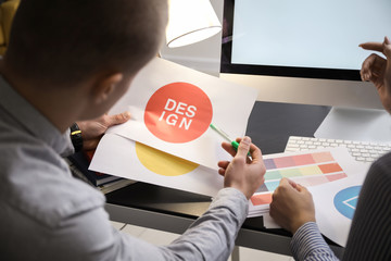 Designers working on new logo in office