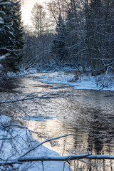 forest river in winter. Amata in Latvia