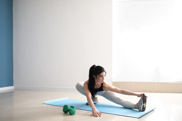 Sporty muscular woman training in gym