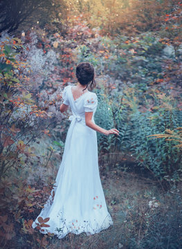 innocent charming girl in a long white vintage expensive dress got lost in the forest, lost her way, cool colors, fabulous art processing, no face, magic elf princess in the real world by mistake