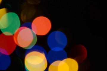 Bokeh. Christmas lights. Holiday background. Garland. Glitter. Defocused sparkles. Festive. New...