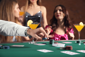 Group of people playing poker in casino