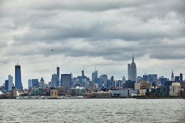 New York city skyline from ferry boat on the ocean, State of Liberty travel
