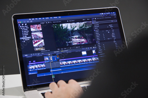 Video editing with laptop  Professional editor adding