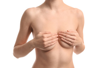 Young woman with beautiful breast on white background