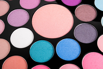 Palette of cosmetic eye shadow for make-up. Fashion and beauty background