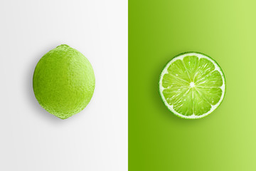 Creative background, lime and lime slices on a white and green background. Flat lay, copy space, layout. The concept of nutrition, fresh fruit, natural products, juice.