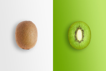 Creative background, kiwi and kiwi slices on a white and green background. Flat lay, copy space, layout. The concept of nutrition, fresh fruit, natural products, juice. Wall mural
