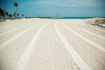 Road to the beach. Lines in the sand. White sand