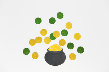 st patricks day, holidays and celebration concept - pot of gold and coins made of paper on white background