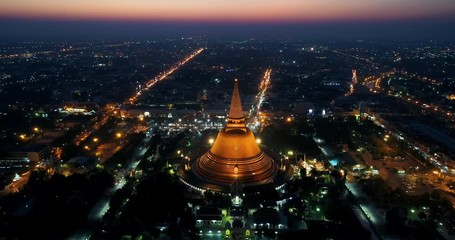 Wall Mural - Aerial view of Beautiful Gloden pagoda at sunset. Phra Pathom Chedi temple in Nakhon Pathom Province, Thailand.